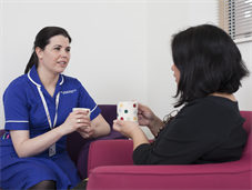 Clinical nurse specialist talking with patient