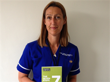 Clinical Nurse Specialist Michelle Kenyon holds handbook The Seven Steps: The Next Steps