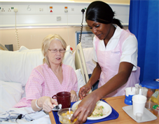 Medirest hostess serving food to patient