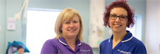 Two King's nurses smiling at camera