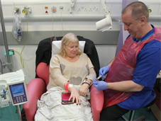 Clinical Nurse Specialist attending to patient receiving chemotherapy