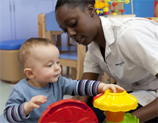 Child playing with nurse
