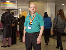 King's volunteer Barrie Armstrong in hospital corridor