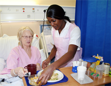 hostess serving a meal to a patient