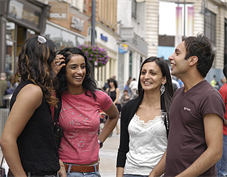 4 people in a high street chatting