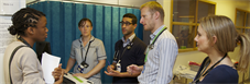 Group of medical professionals in discussion during ward rounds