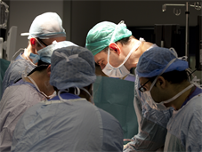 Close up of masked surgeons in operating theatre