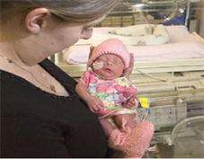 Neonatal unit - woman with baby
