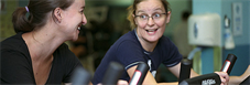 Women on cycles in gym