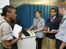 Clinical staff in group discussion on ward