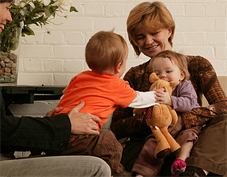 Mothers playing with children in nursery