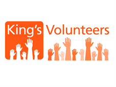 Hands reaching up to words saying King's Volunteers